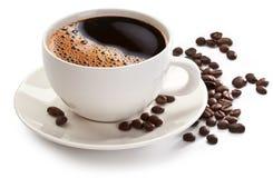 Taza y habas de café Imagen de archivo libre de regalías