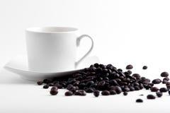 Taza y habas de Coffe Imagen de archivo