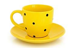 Taza y platillo amarillos Fotografía de archivo libre de regalías
