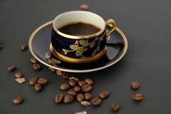 Taza y platillo de café antiguos Foto de archivo