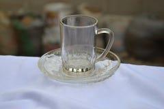 Taza y platillo de cristal Foto de archivo libre de regalías