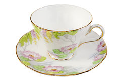 Taza y platillo de té antiguos viejos Imagenes de archivo
