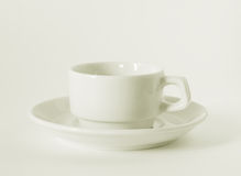 Taza y platillo del café con leche Imagenes de archivo
