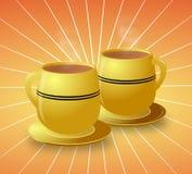 Tazas amarillas de café caliente en el fondo de Starburst Fotografía de archivo