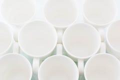 Tazas blancas Imágenes de archivo libres de regalías