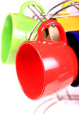 Tazas coloreadas Imágenes de archivo libres de regalías