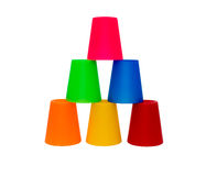 Tazas coloreadas apiladas Fotos de archivo libres de regalías