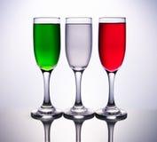 3 tazas coloreadas con la bandera italiana Imágenes de archivo libres de regalías