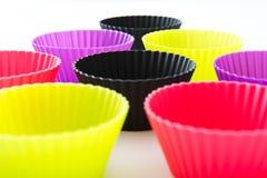 Tazas coloreadas del mollete Imagen de archivo libre de regalías