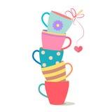 Tazas coloreadas encendido encima de otra Imagen de archivo libre de regalías