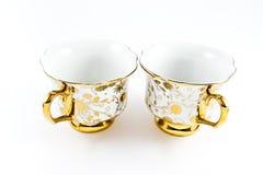 Tazas de café adornadas de oro de la porcelana Imagenes de archivo
