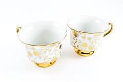 Tazas de café adornadas de oro de la porcelana Imagen de archivo
