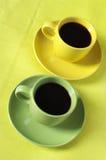 Tazas de café amarillas y verdes Imagen de archivo libre de regalías