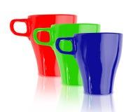 Tazas de café azulverdes rojas del color Fotografía de archivo