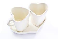 Tazas de café blancas del amor Imagen de archivo libre de regalías