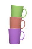 Tazas de café coloridas en blanco Foto de archivo libre de regalías
