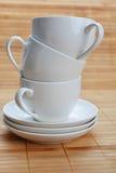 Tazas de café con los platillos Foto de archivo