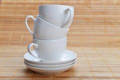 Tazas de café con los platillos Imagen de archivo