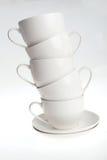 Tazas de café con los platillos Fotos de archivo libres de regalías