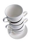 Tazas de café con los platillos Foto de archivo libre de regalías