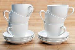 Tazas de café con los platillos Imagenes de archivo