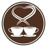 Tazas de café con vapor en forma del corazón Fotos de archivo libres de regalías