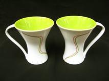 Tazas de café del diseñador Imagenes de archivo