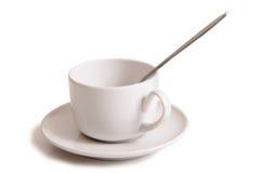 Tazas de café en el fondo blanco Imagenes de archivo