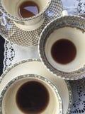 Tazas de café en el vector Foto de archivo
