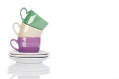 Tazas de café coloridas sujetadas con grapa Fotografía de archivo libre de regalías