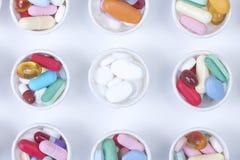 Tazas de la medicación Imagen de archivo