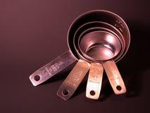 Tazas de medición del acero inoxidable Imagen de archivo libre de regalías