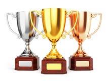 Tazas de oro, de plata y de bronce del trofeo Foto de archivo libre de regalías