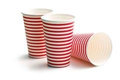 Tazas de papel rayadas Imagen de archivo libre de regalías