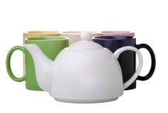 Tazas de té con la tetera Fotos de archivo