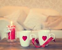 Tazas de té del corazón Imagenes de archivo