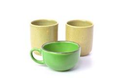 Tazas de té en el fondo blanco Fotos de archivo libres de regalías