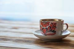 Tazas de té en la tabla de madera Imagen de archivo libre de regalías