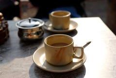 Tazas de té en un vector Fotografía de archivo libre de regalías