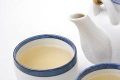 Tazas de té y tetera Foto de archivo libre de regalías