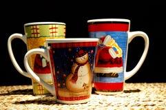 Tazas del chocolate caliente de la Navidad Fotos de archivo libres de regalías
