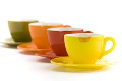 Tazas del color Imagenes de archivo