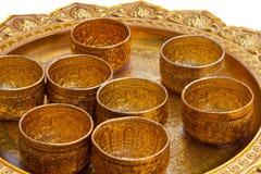 Tazas del oro con el camino de recortes Fotografía de archivo libre de regalías