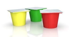 Tazas del yogur Fotografía de archivo libre de regalías