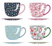 Tazas para el té con los modelos Imágenes de archivo libres de regalías
