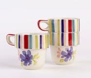 Tazas pintadas a mano preciosas Foto de archivo libre de regalías