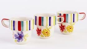 Tazas pintadas a mano preciosas Fotografía de archivo