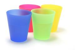 Tazas plásticas Foto de archivo libre de regalías