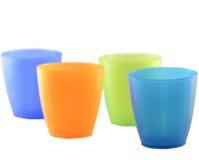 Tazas plásticas coloreadas Foto de archivo