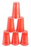 Tazas plásticas rojas Imagen de archivo libre de regalías